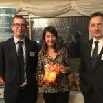 Liz congratulates local business on physics award