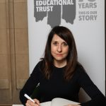 Liz signs Holocaust Educational Trust Book of Commitment