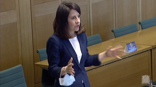 Image of Liz speaking in the debate