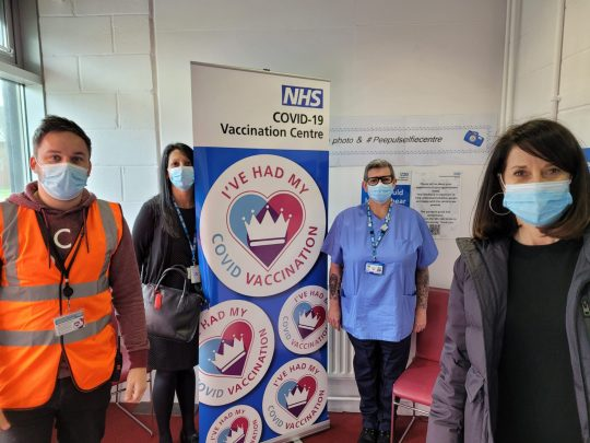 Liz Kendall with three staff and volunteers from the Peepul Centre vaccination centre in Leicester